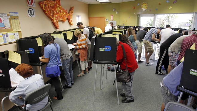 Florida residents cast ballots in Miami Beach on Saturday.
