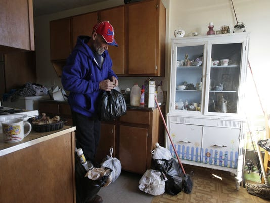 Hector N Bags Up Household Garbage In His Seventh Floor Carey Gardens Apartment Operated By The New York City Housing Authority On Sunday