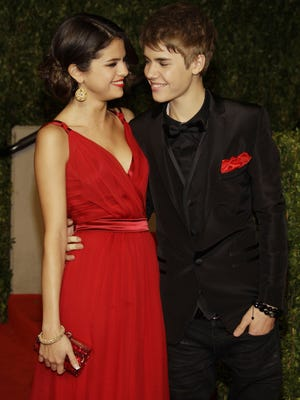 Selena Gomez and Justin Bieber are shown Feb. 27, 2011, arriving at the Vanity Fair Oscar Party in Los Angeles.