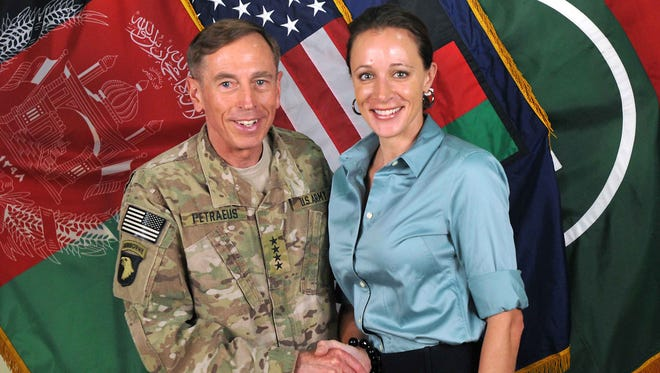 This July 13, 2011 handout image provided by NATO shows David Petraeus shaking hands with his biographer, Paula Broadwell, in Afghanistan.