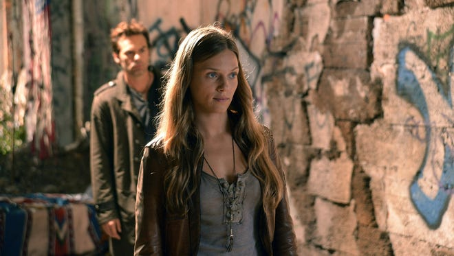 The good news for NBC: 'Revolution,' starring Billy Burke, left, and Tracy Spiridakos, is the top new show among viewers 18 to 49. The bad news: Viewers tend to watch the show up to a week later and advertisers only pay the network for the first three days.