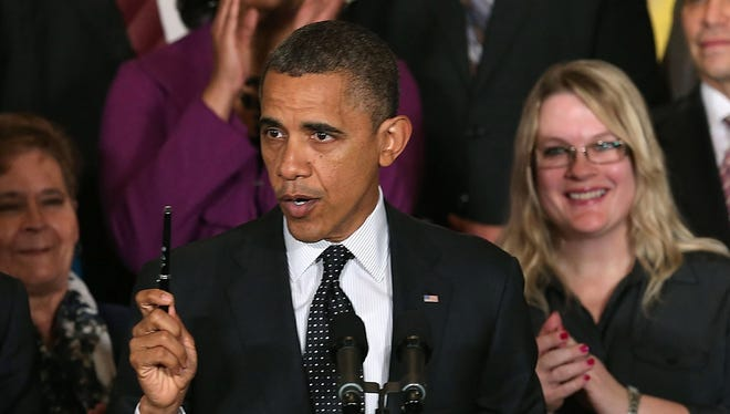 "President Obama speaks to the media on Friday. The president said he'd invited congressional GOP leaders to the White House to discuss ways of avoiding the ""fiscal cliff."""