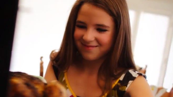 Nicole Westbrook cooks turkey in the music video for her song 'It's Thanksgiving.'