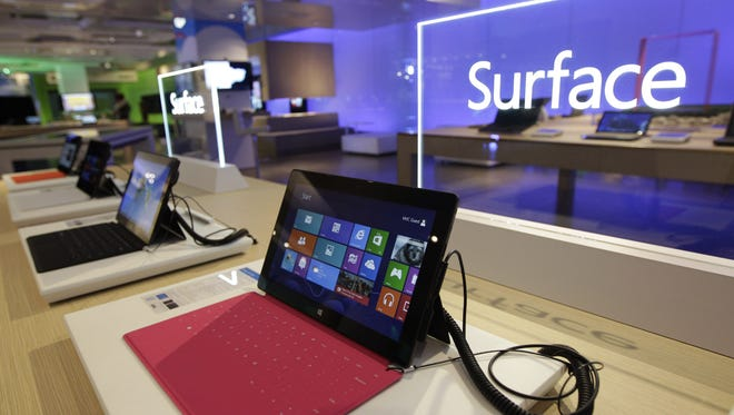 """Microsoft Surface touchscreen tablet computers running the Windows 8 operating system are shown at """"Build,"""" Microsoft Corp.'s developers conference, Wednesday, Oct. 31, 2012, in Redmond, Wash."""