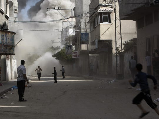 Palestinians run to take cover