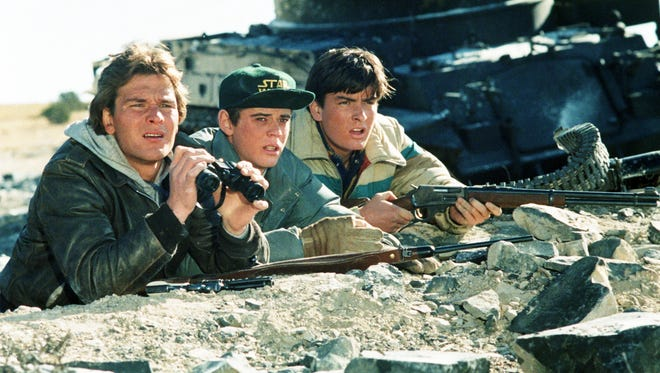 Patrick Swayze, left, C. Thomas Howell and Charlie Sheen starred as the original Wolverines in 1984's 'Red Dawn.'
