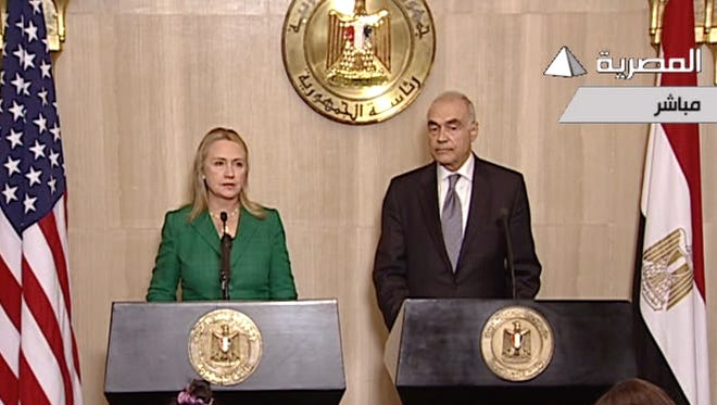 Secretary of State Hillary Rodham Clinton  and Egyptian Foreign Minister Mohamed Kamel Amr announce a cease-fire between Israel and Hamas in Cairo.