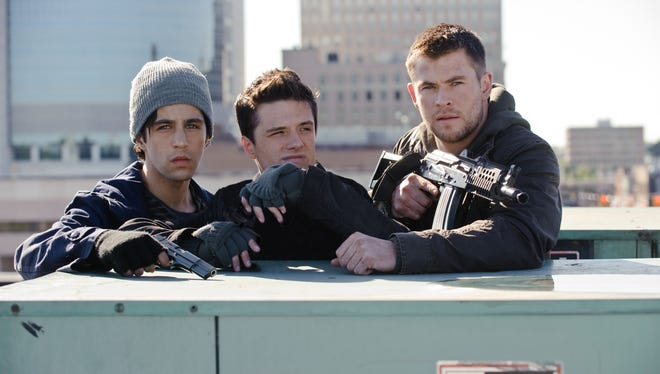 "Josh Peck , left, Josh Hutcherson, center, and Chris Hemsworth in a scene from ""Red Dawn."" (AP Photo/Film District)"