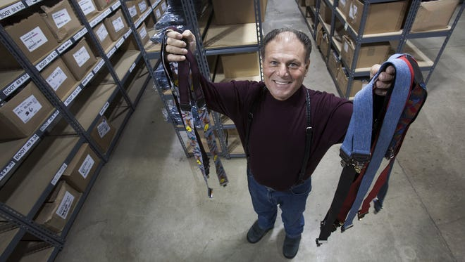 Sal Herman, 66, displays suspenders in his Southfield, Mich., warehouse on Nov. 1. About 2,400 stores nationwide sell his suspenders.