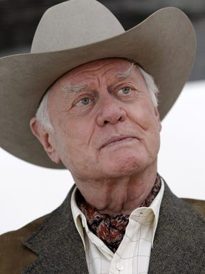 """Actor Larry Hagman talks in an interview during filming of the rebooted """"Dallas"""" in 2011."""