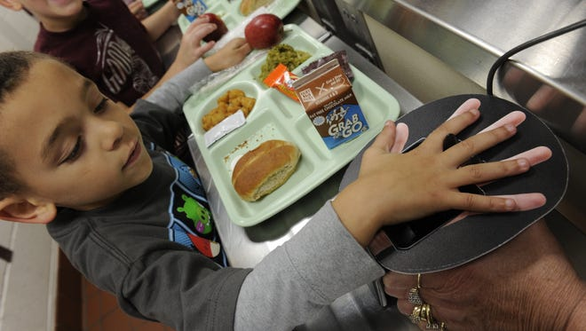 Students at Cranberry Station Elementary School in Westminster, Md., use a palm-scanning device to pay for their school lunches.