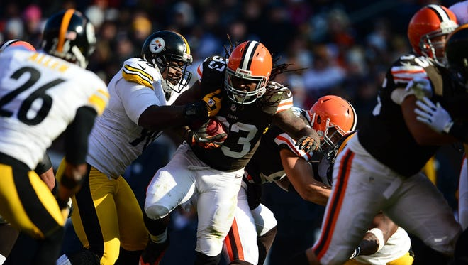 Cleveland Browns running back Trent Richardson breaks through the line against the Pittsburgh Steelers in the second quarter in Week 12 action.
