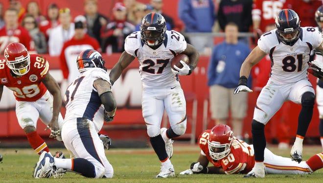 Denver Broncos running back Knowshon Moreno (27) bursts through a hole against the Kansas City Chiefs on Nov. 25, 2012 at Arrowhead Stadium.