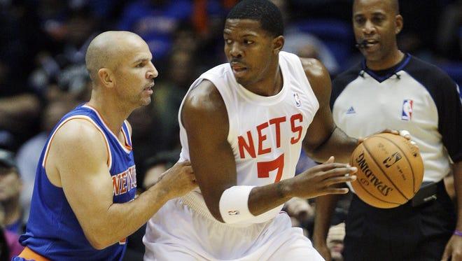 Knicks guard Jason Kidd defends Nets guard Joe Johnson during a preseason game.
