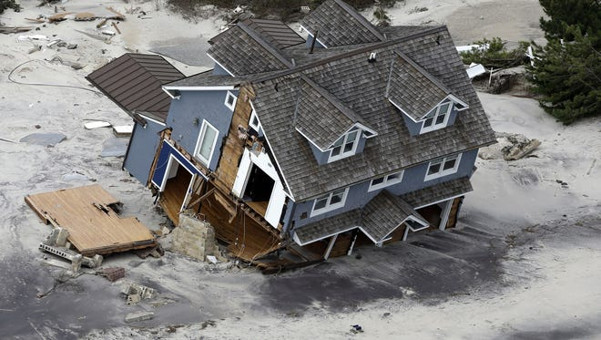 An aerial view of a collapsed house along the central Jersey Shore coast.