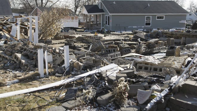 Rubble is all that remains of the Yurgelonis home, foreground, in Union Beach, N.J. on November 20 in the wake of Hurricane Sandy.