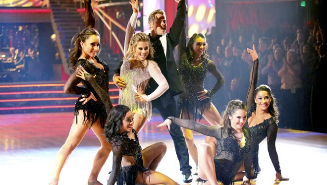 Shawn Johnson and Derek Hough, center, surrounded by the U.S. Women's Olympic Gymnastics Team, take a bow Monday on 'Dancing With the Stars.'