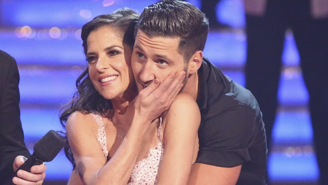 Kelly Monaco and Val Chmerkovskiy embrace after their Monday performance.