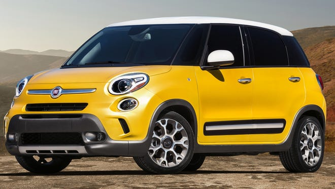 Fiat 500L is due second quarter next year, for people who like the quirky 500 but need more space.Trekking model is shown.