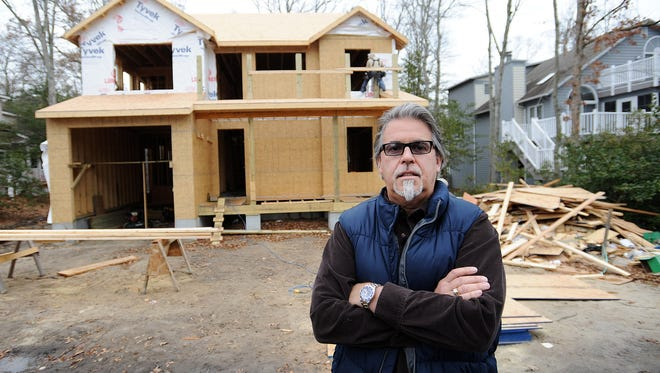 Bruce Mears, a contractor building this new house on Nov. 27 in Bethany Beach, Del., knows that a town ordinance prohibits construction work on Thanksgiving. But he wasn't expecting police to cite him $150 for having a crew working on Black Friday.