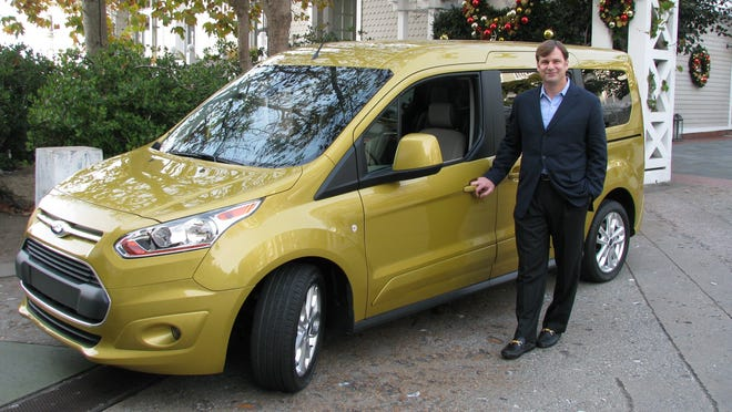 Ford marketing chief JJim Farley shows off the 7-passenger version of the new Transit Connect minivan in Santa Monica, Calif. hotel at an L.A. Auto Show event.