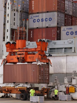 A container ship is loaded at Massport's Conley Terminal in the port of Boston in this file photo.
