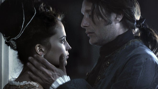 Alicia Vikander, left, and Mads Mikkelsen star in 'A Royal Affair,'  a fascinating chapter in Danish  history presented in an engaging fashion.