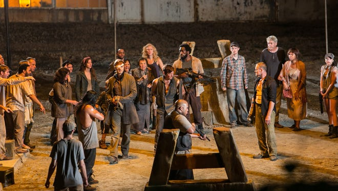 At the close of 'The Walking Dead's midseason finale Sunday night,  The Governor (David Morrissey) and his people hand down a death sentence for Daryl Dixon (Norman Reedus) and Merle Dixon (Michael Rooker), left to right in center, in the town of Woodbury's gladiator pit.