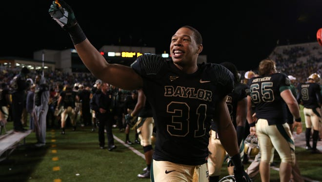 Baylor defensive end Chris McAllister celebrates after the Bears defeated Kansas State on Nov. 17.