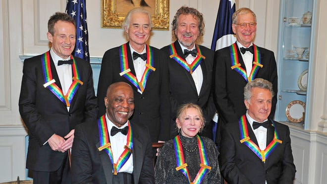 (L-R Back Row)  John Paul Jones, Jimmy Page, Robert Plant, David Letterman (L-R Front Row) U.S. Secretary of State Hillary Rodham Clinton, Buddy Guy, Natalia Makarova, Dustin Hoffman pose following a dinner for Kennedy honorees hosted by U.S. Secretary of State Hillary Rodham Clinton at the U.S. Department of State.