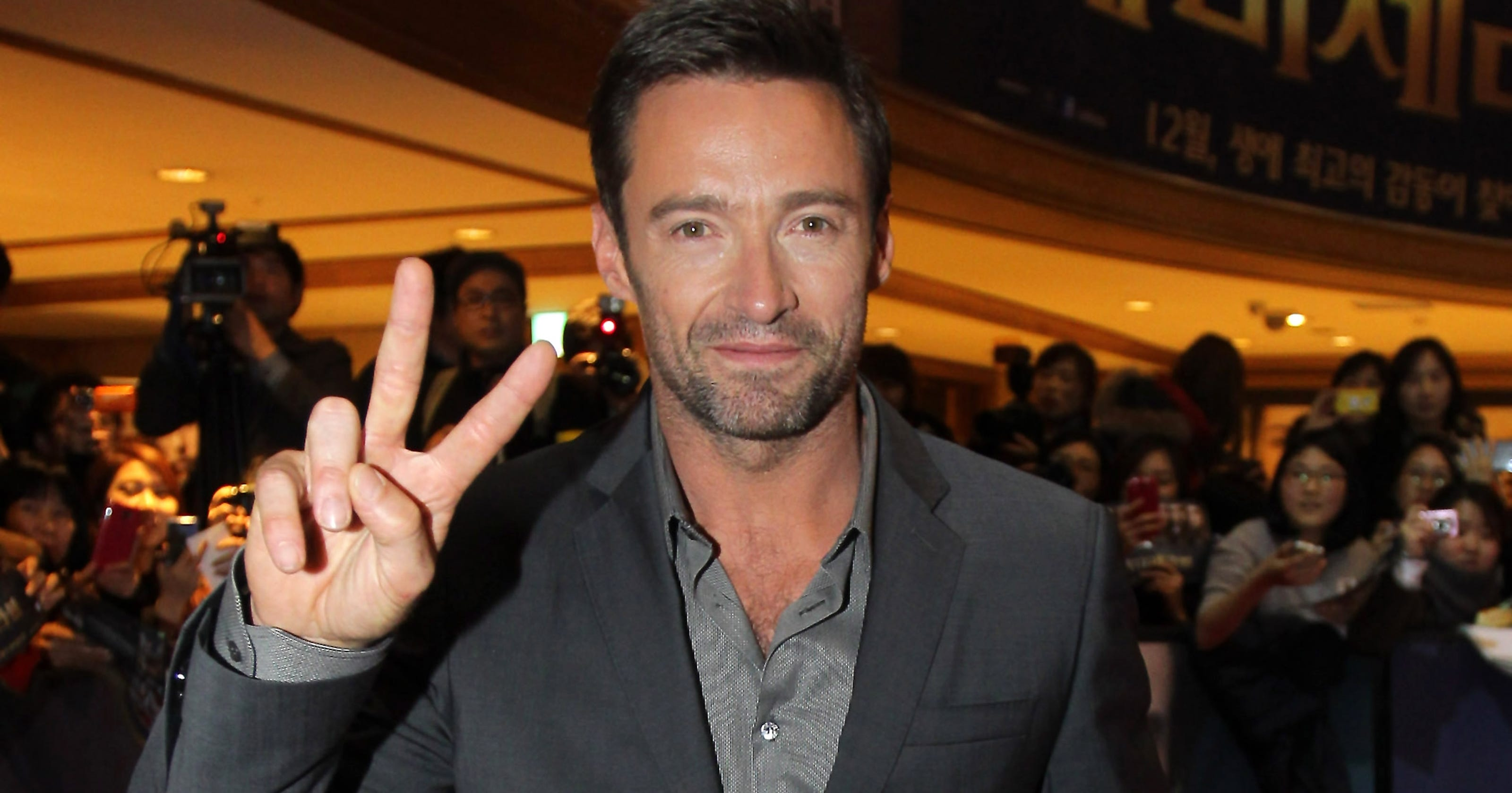ed64a355b23 Hugh Jackman hawks his java at junket for a good cause