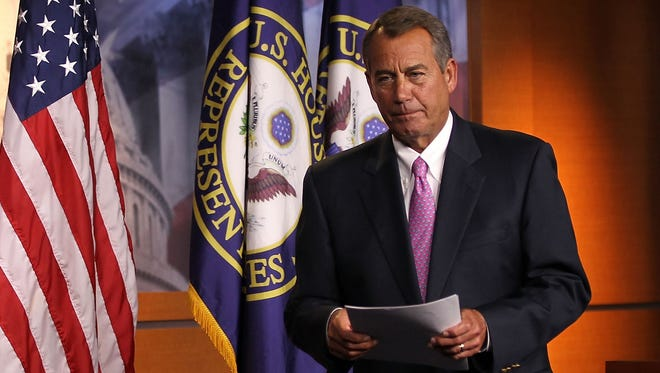 House Speaker John Boehner, R-Ohio, leaves a news conference on Capitol Hill on Friday.