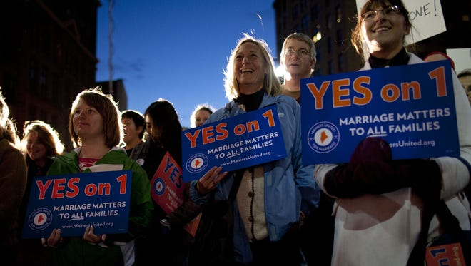 Gay marriage supporters rally in Portland, Maine, on Nov. 1. A USA TODAY/Gallup Poll finds growing acceptance among Americans toward gay men and lesbians.