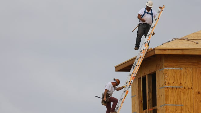 Construction workers at a Toll Brothers'  home in the Azura community in November in Boca Raton, Fla.