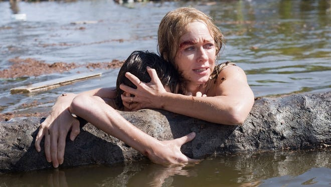 Naomi Watts and Tom Holland struggle to survive in 'The Impossible,' based on a true story of the Southeast Asia tsunami of 2004.