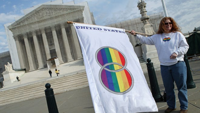 Same-sex marriage proponent Kat McGuckin of Oaklyn, N.J., stands outside the Supreme Court on Nov. 30.