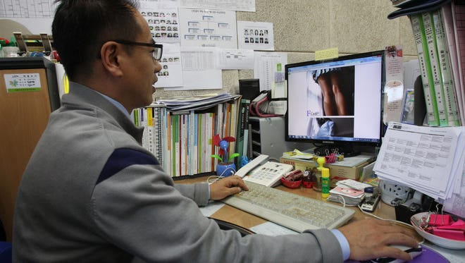 Moon Tae Hwa, a devout Christian and family counselor, uses a desktop computer to hunt down online pornography at his office in Seoul.