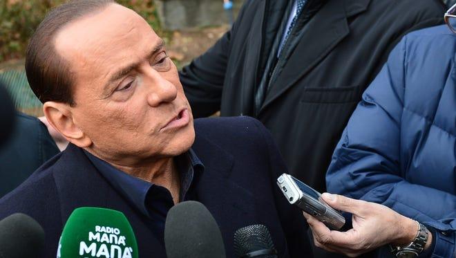 Italian former prime minister Silvio Berlusconi speaks to the press in Milanello on Dec. 8.
