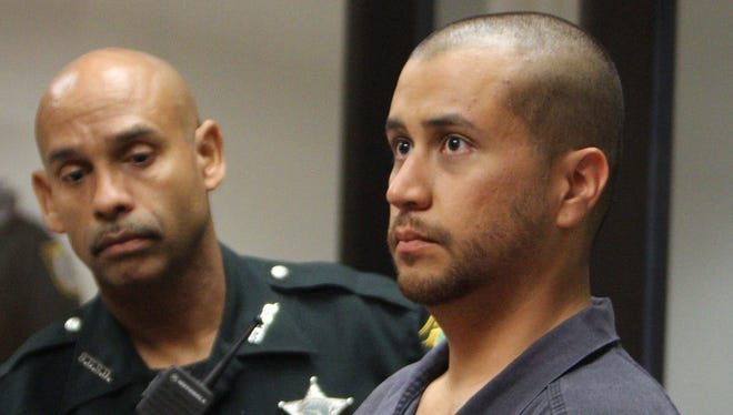 George Zimmerman stands with a Seminole County deputy during a court hearing in April in Sanford, Fla.