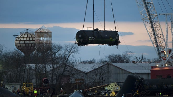 A large crane removes a rail car that leaked vinyl chloride from its crash site in Paulsboro, N.J., on Tuesday, Dec. 11, 2012. Removal of the damaged rail car from Mantua Creek marked a milestone in cleanup efforts in the wake of the Nov. 30 derailment.