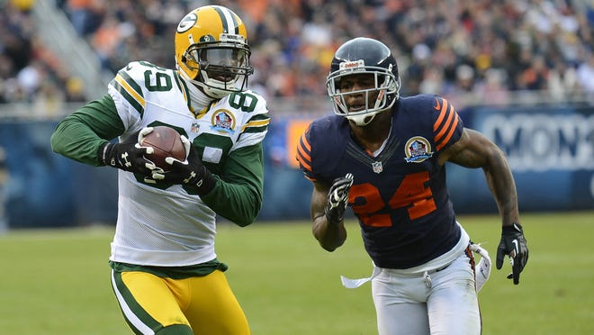 Green Bay Packers wide receiver James Jones (89) catches a touchdown against Chicago Bears cornerback Kelvin Hayden (24) during the second quarter at Soldier Field in Chicago.