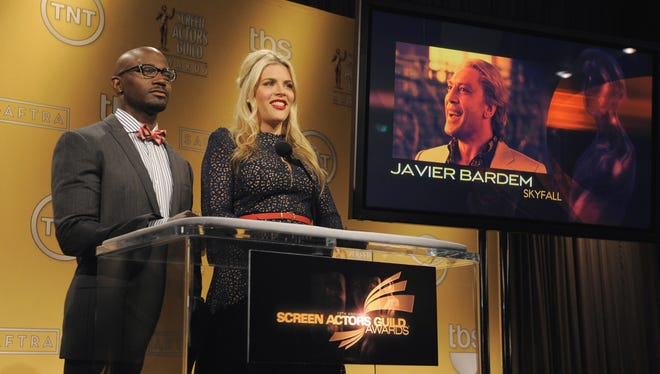 Actors Taye Diggs, left, and Busy Philipps announce Javier Bardem as a nominee for Oustanding Performance by a Male Actor in a Supporting Role for 'Skyfall' during the nominations for the 19th Annual Screen Actors Guild Award.
