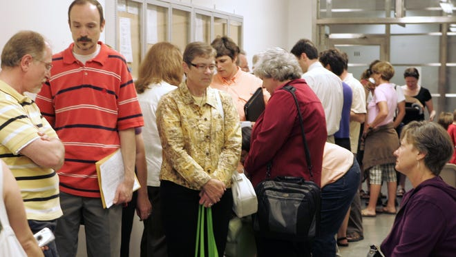 A number of same-sex couples wait in line to apply for a state declaration of domestic partnership on 3, 2009 at the Dane County City-County Building in Madison, Wis.