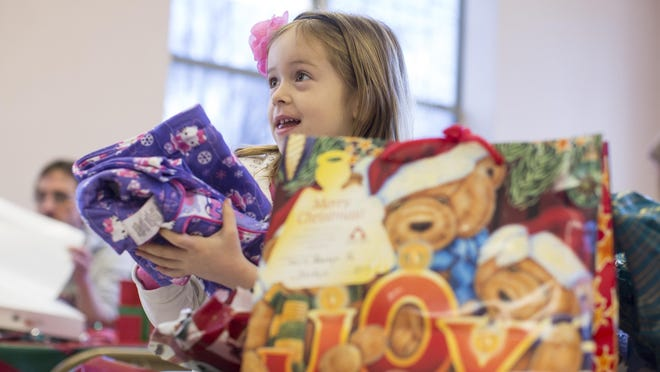 Jordyn McCallister, 5, opens a present during a party Dec. 15 by the Prison Fellowship Angel Tree Christmas Program in Granite City, Ill. A friend of Jordyn's family is currently incarcerated.