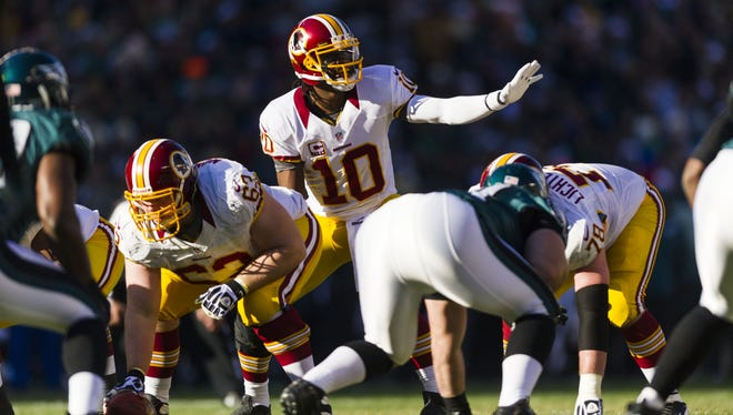 Washington Redskins quarterback Robert Griffin III (10) under center during the second quarter against the Philadelphia Eagles at Lincoln Financial Field.