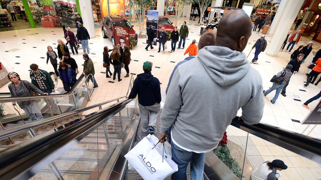 People crowd the mall for holiday shopping ahead of Christmas at Twelve Oaks Mall on Saturday in Novi, Mich.