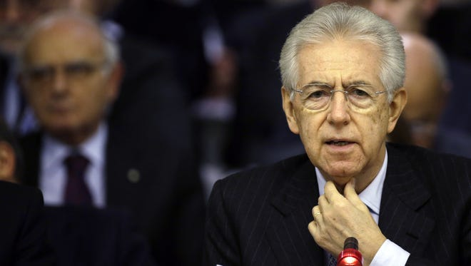 Italian Premier Mario Monti delivers a speech at the Foreign Ministry for the Italian Ambassadors conference in Rome Friday.