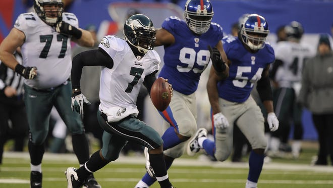 Philadelphia Eagles quarterback Michael Vick scrambles for a first down during a fourth-quarter rally against the New York Giants on Dec. 19, 2010 in East Rutherford, N.J.