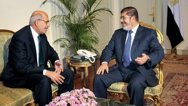 Nobel Peace Prize winner and head of the opposition political party Mohammed ElBaradei, left, meets with  Egyptian President Mohammed Morsi in Cairo.