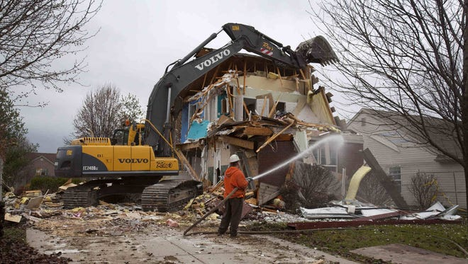 A home in the Richmond Hill neighborhood of Indianapolis is demolished Dec. 4 following a deadly November explosion that killed two people and ruined numerous homes.